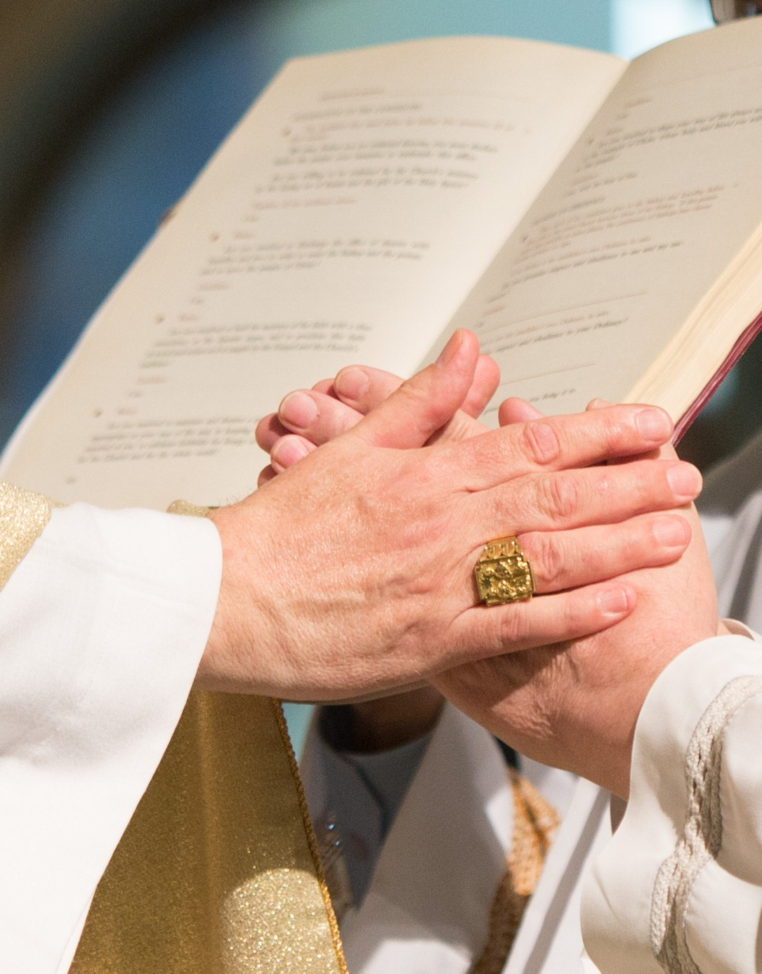 Picture shows candidate placing his hands in the hands of the Bishop pledging his obedience to the Archbishop and his successors